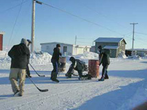 Igloolik children playing street hockey